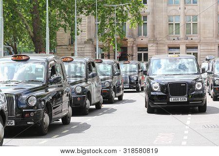 London England - June 3, 2019: Taxi Black Cab Parked At Euston Station London Uk