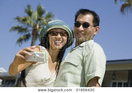 Couple Taking Their Own Photo