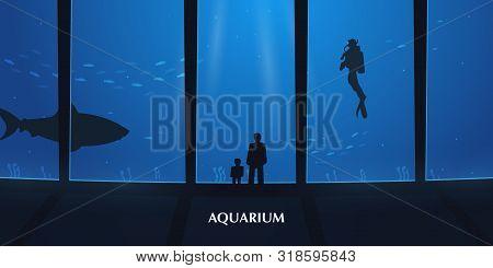 Big Aquarium Or Oceanarium With Shark. People Watching The Underwater World.