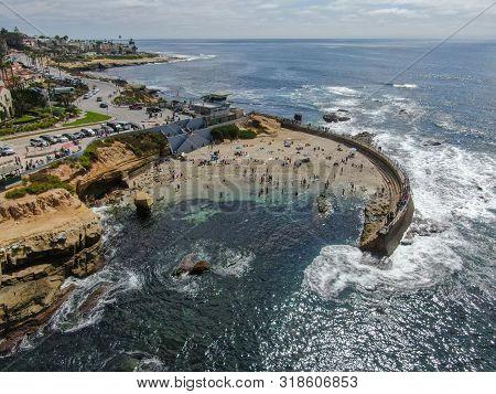 Beachgoers Enjoying A Beautiful Sunny Afternoon At La Jolla Cove In San Diego, Ca. Usa. Famous Touri