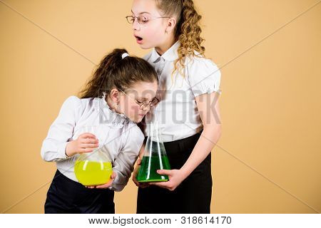 Knowledge and information. Experimenting together. Education concept. Fascinating experiment. Basic knowledge. Knowledge day. Schoolgirls friends with chemical liquids. Childhood and upbringing poster