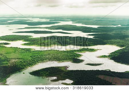 Landscape Aerial View Of Colorful Amazon Rivers, Forest, Jungle, And Fields