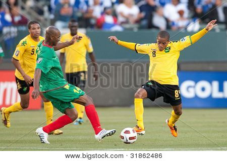 CARSON, CA. - JUNE 6: Grenada D Leon Johnson #14 (L) & Jamaica D Eric Vernan #8 (R) during the 2011 CONCACAF Gold Cup group B game on June 6, 2011 at the Home Depot Center in Carson, CA.