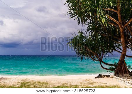 Beautiful Landscape Of Tropical Beach With Turquoise Sea And White Sand. Summer Vacation Concept.