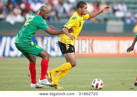 CARSON, CA. - JUNE 6: Grenada D Leon Johnson #14 (L) & Jamaica F Ryan Johnson #9 (R) during the 2011 CONCACAF Gold Cup group B game on June 6, 2011 at the Home Depot Center in Carson, CA.