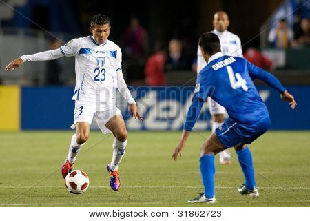 CARSON, CA. - JUNE 6: Honduras M Edder Delgado #23 (L) & Guatemala M Carlos Castrillo #4 (R) during the 2011 CONCACAF Gold Cup group B game on June 6, 2011 at the Home Depot Center in Carson, CA.