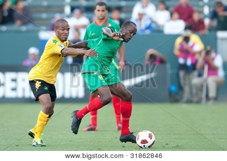 CARSON, CA. - JUNE 6: Jamaica M Dane Richards #11 (L) & Grenada M Ricky Charles #9 (R) in action during the 2011 CONCACAF Gold Cup group B game on June 6, 2011 at the Home Depot Center in Carson, CA.