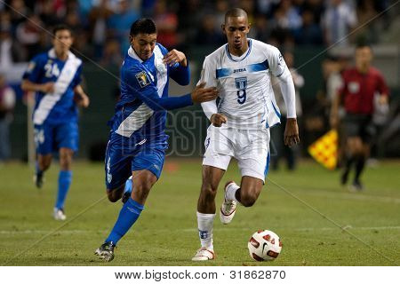 CARSON, CA. - JUNE 6: Guatemala M Carlos Castrillo #4 (L) & Honduras F Jerry Bengtson #9 (R) during the 2011 CONCACAF Gold Cup group B game on June 6, 2011 at the Home Depot Center in Carson, CA.
