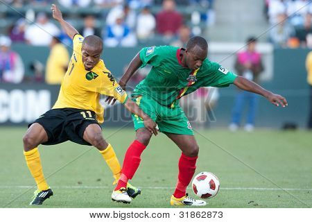 CARSON, CA. - JUNE 6: Grenada D Anthony Straker #15 (R) & Jamaica M Dane Richards #11 (L) in action during the 2011 CONCACAF Gold Cup group B game on June 6, 2011 at the Home Depot Center in Carson, CA.