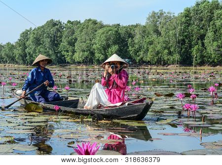 Woman Sitting On The Wooden Boat