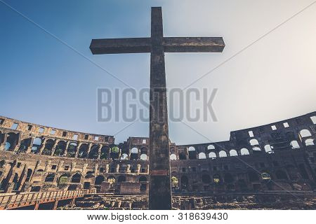 Rome / Italy - May 13, 2019: Cross Inside The Colosseum Of Rome In Italy. Flavian Amphitheater, Anti