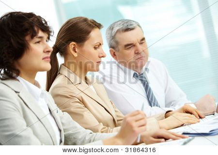 Attentive businesspeople being concentrated on their work