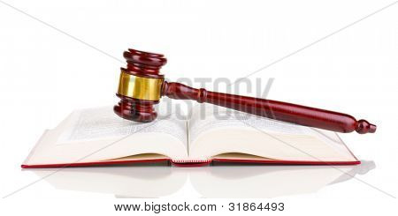 Judge's gavel and open book isolated on white
