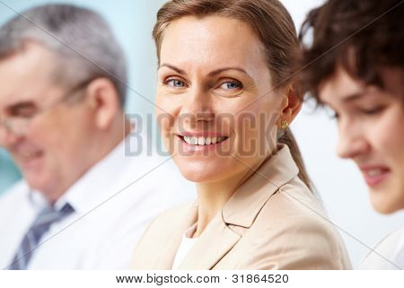 Smiling business woman looking directly at camera