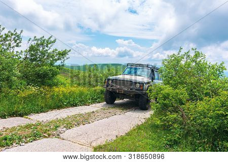 Mnt. Runa, Ukraine - Jun 19, 2019: Old Off Road Vehicle On The Paved Mountain Road. Dirty Suv Prepar