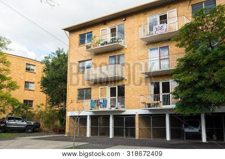 Melbourne, Australia - June 9, 2019: Brick Low-rise Apartment Building In Oshanassy Street, A Wide R