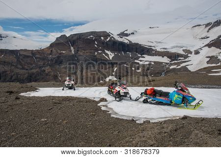 Vatnajokull Iceland - June 17. 2019: Snowmobiles Near Vatnajokull Glacier On A Sunny Summer Day