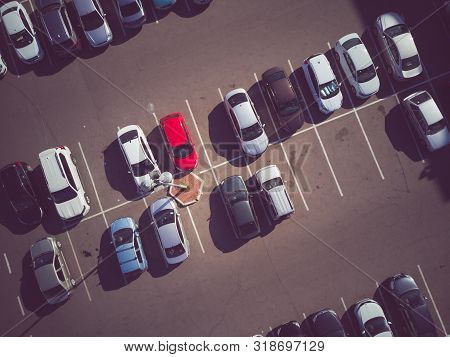 A View From Above To The Process Of Car Parking. Heavy Traffic In The Parking Lot. Searching For Spa