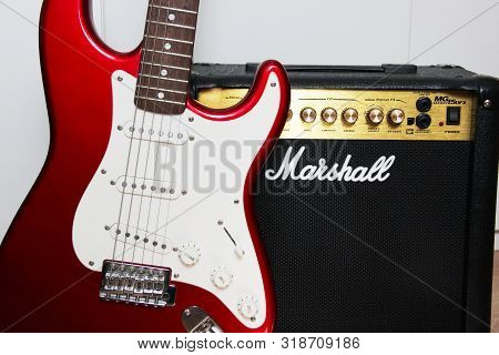 Moscow, Russia - March 11, 2018: Close Up Of A Marshall Guitar Amplifier And A Red Electric Guitar