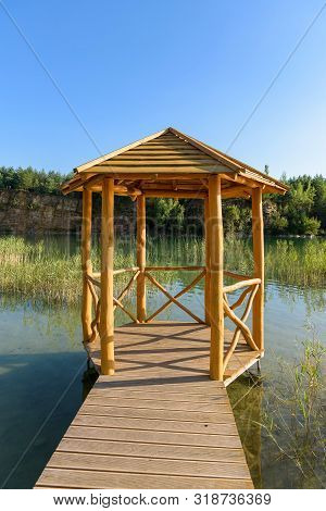 Wooden Bower On The Pond In An Old Quarry In Grodek Park In Jaworzno