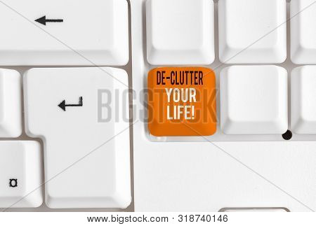 Writing note showing De Clutter Your Life. Business photo showcasing remove unnecessary items from untidy or overcrowded places White pc keyboard with note paper above the white background. poster