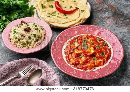 Paneer Makhani And Jeera Rice In Pink Plates On Dark Background. Paneer Makhani Is An Indian Cuisine