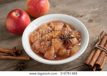 Homemade Apple Chutney (apple Jam, Marmalade, Chunky Sauce) With Cinnamon, Anise And Apples On Woode