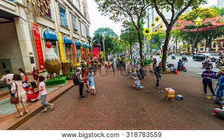 Ho Chi Minh City, Vietnam – 2019. Locals Gathering On The Streets Of The Old Town Of Ho Chi Minh.