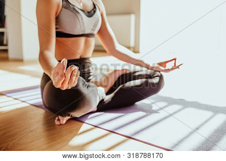 Yogi Woman Practicing Yoga Lesson, Breathing, Meditating, Doing Ardha Padmasana Exercise, Half Lotus