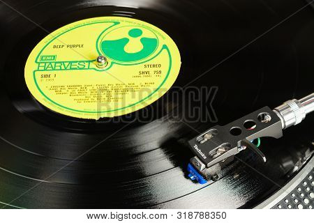 London, England - May 08, 2019: Vintage Vinyl Record With Emi Harvest Label Played On Technics Turnt