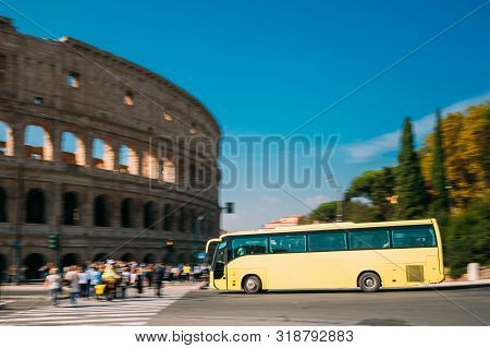 Rome, Italy. Colosseum. Yellow Bus Moving On Street Near Flavian Amphitheatre. Famous World Unesco L