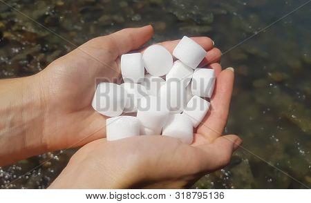 Salt Pellets For The Water Softener. Salt In Female Hands