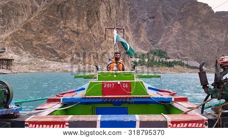 Boating At Beautiful Tourist Place And Blue Water Lake, Attabad Lake In Gilgit Baltistan, Pakistan 1