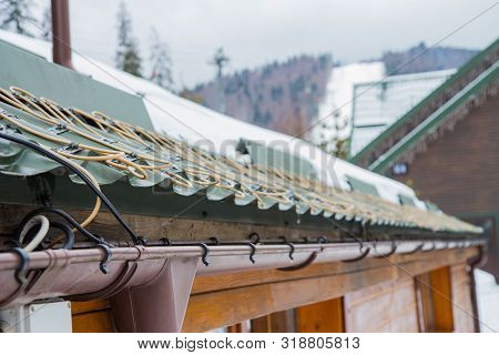 roof anti-icing system, for draining melt water. Heated drainpipe with an electric cable from freezing ice poster