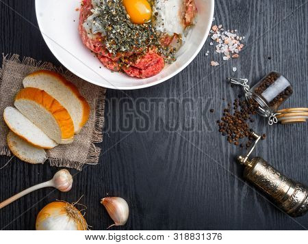 Preparing Meatball With Ingredients, Such As Egg, Meat, Bread, Onion, Garlic, Herbs On Wooden Board,