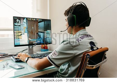 Madrid, Spain - August 23, 2019: Teenager Playing Counter Strike Global Offensive Video Game On Pc.