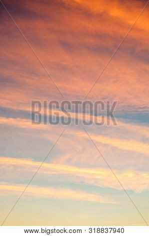Blue dramatic sunset sky background - picturesque colorful clouds lit by sunlight. Vast sky landscape panoramic scene in soft pastel tones, sunset sky view