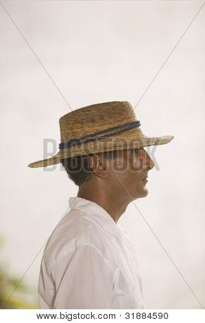 Side view portrait of man in straw hat