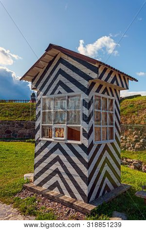 Striped Classic Watchtower For The Sentry In The Korela Fortress On A Summer Day Under A Blue Sky Ag