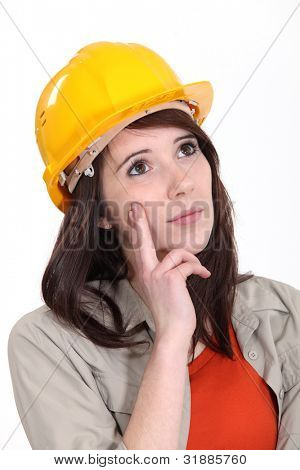 Tradeswoman daydreaming