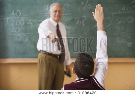 Teacher calling on student to answer a question