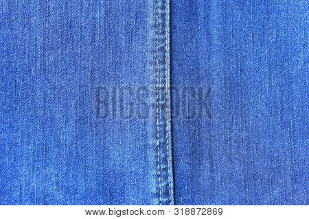An Abstract Image Of Old And Worn Blue Denim Fabric.