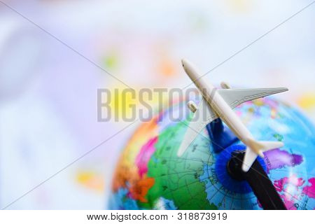 Travel Background Concept - Airplane Traveler's Fly Airlines Worldwide With Plane On On World Globe