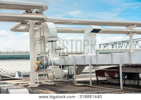 Air Ventilation Exhausting Blower And Chiller Pipe On Roofing Floor Of Manufacturing Power Plant. Bu
