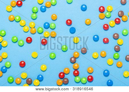 Colorful Candies Background, Copy Space. Nuts In Multi-colored Glaze Dragee. Sweet Candies Spreading