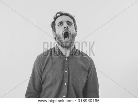 Portrait Of Young Man In Shock With Scared Face Paralysed With Fear And Frightened Face Looking At S