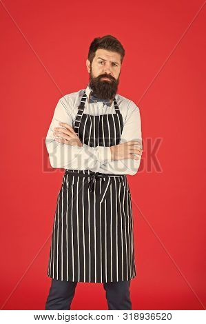 Brutal Bartender. Bearded Bartender In Hipster Style. Serious Bartender Wearing Stylish Work Uniform
