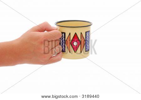 Hand With African Mug