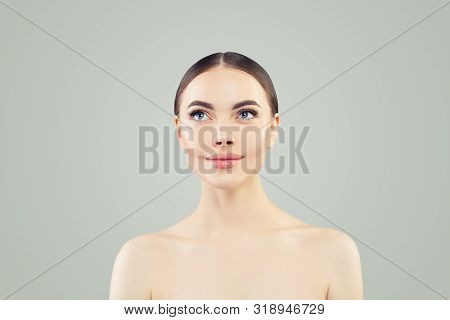 Beautiful Woman Looking Up. Healthy Spa Model With Clear Skin