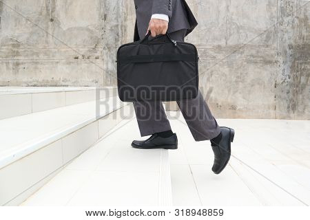 Business Man Step Up Stair.lower Part Of Man In Business Shoes Walking Up Stair,people Lifestyle Suc